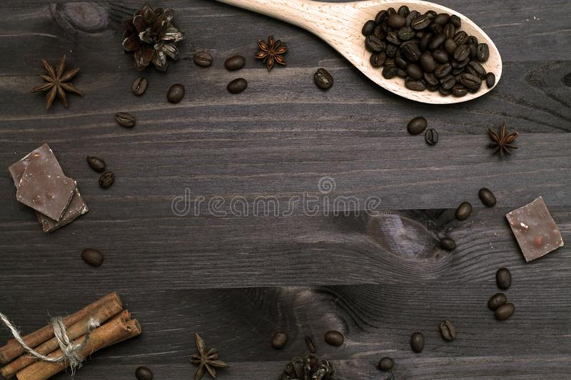 Coffee beans and cinnamon sticks on wooden background royalty free stock image