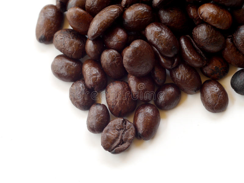 Brown coffee beans isolated on white stock photos