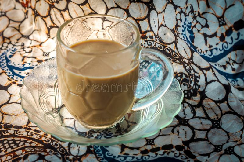 brown color coffee isolated batik fabric stock images