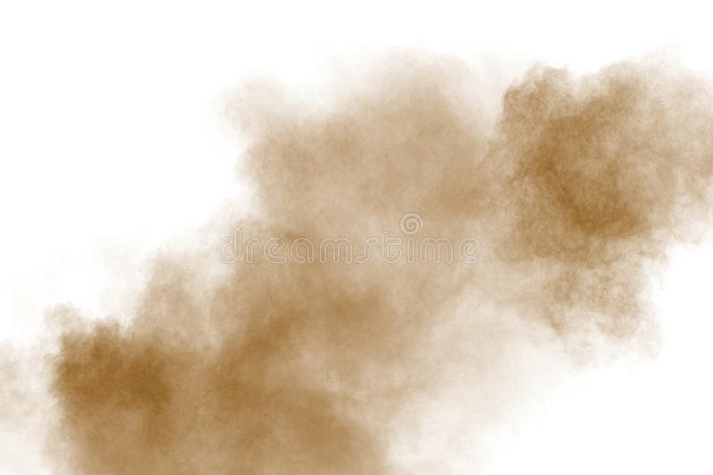 Brown color powder explosion cloud  on white background.Brown dust splashing on  background royalty free stock photos