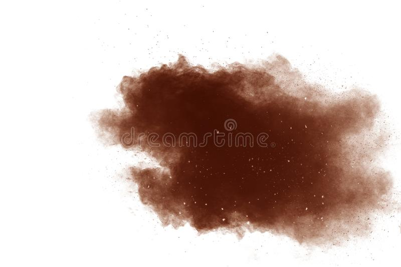 Brown color powder explosion cloud  on white background.Brown dust splashing on  background stock images