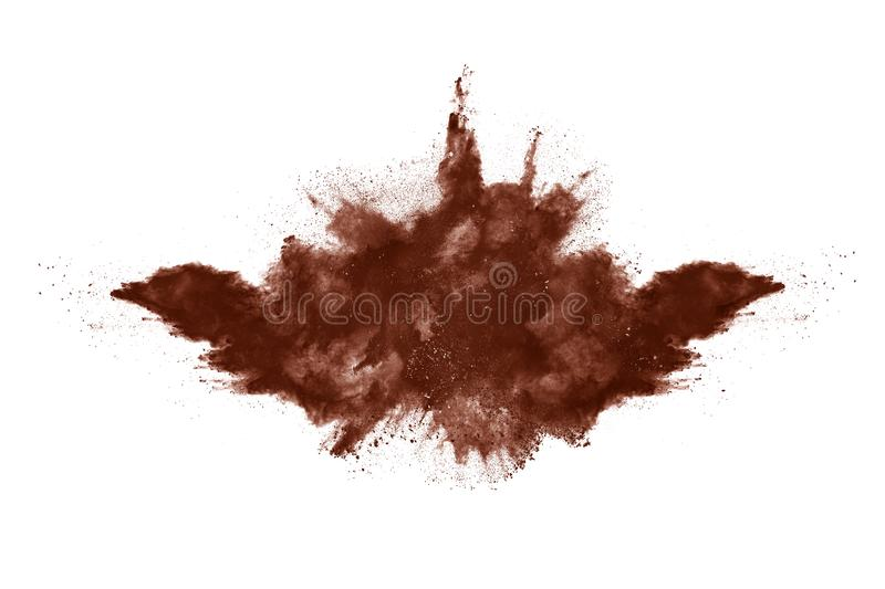 Brown color powder explosion on white background. Colored cloud. Colorful dust explode. Paint Holi royalty free stock photo