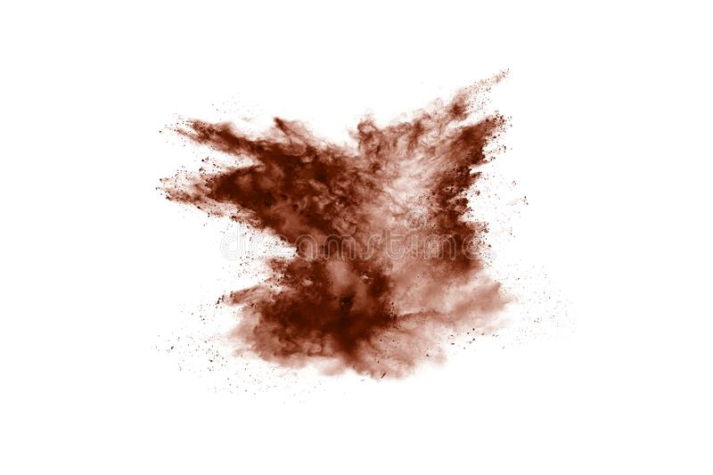 Brown color powder explosion on white background. Colored cloud. Colorful dust explode. Paint Holi royalty free stock photography