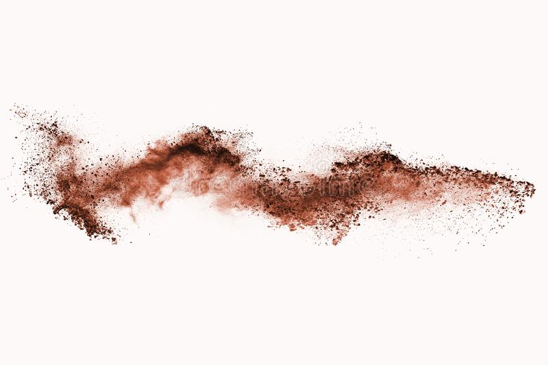 Brown color powder explosion on white background. Colored cloud. Colorful dust explode. Paint Holi stock image
