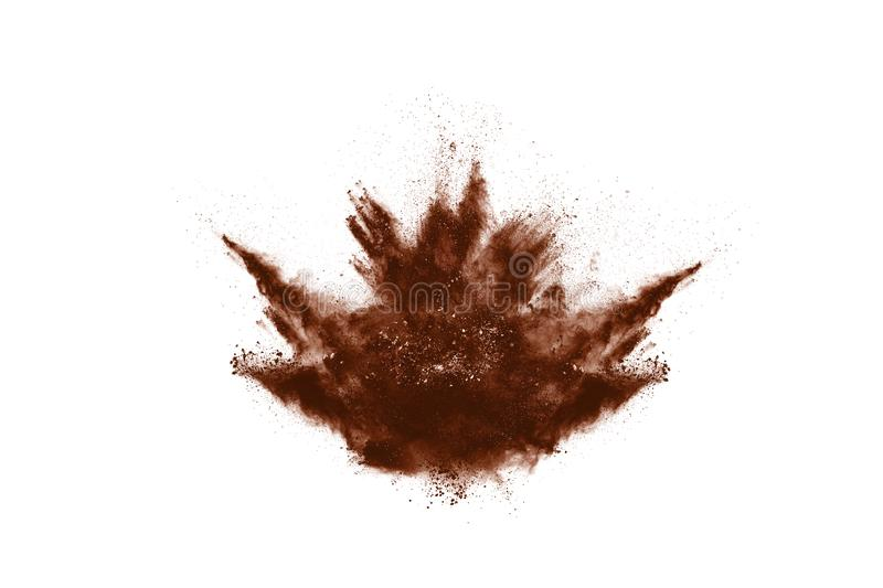 Brown color powder explosion on white background. Colored cloud. Colorful dust explode. Paint Holi royalty free stock images