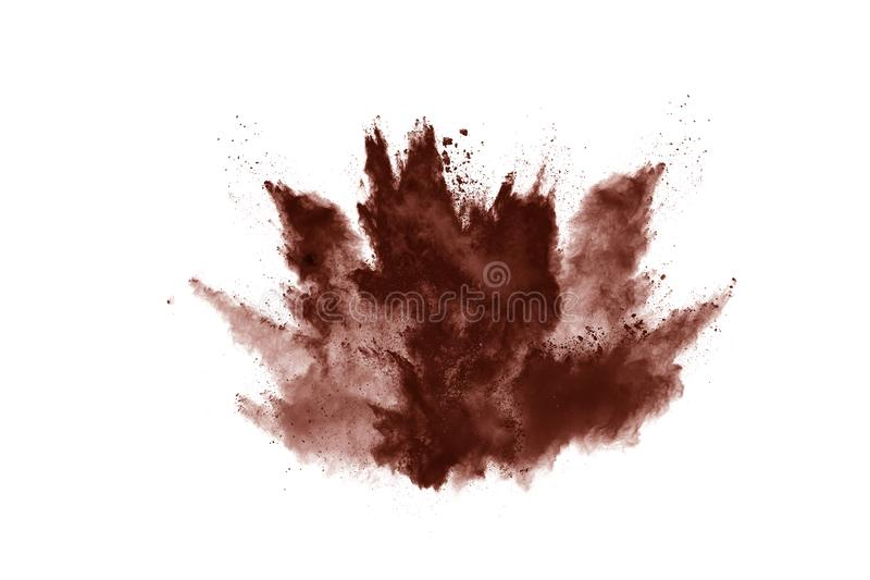 Brown color powder explosion on white background. Colored cloud. Colorful dust explode. Paint Holi royalty free stock image