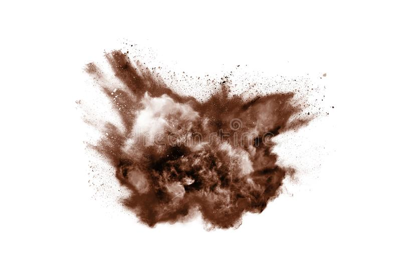 Brown color powder explosion on white background. Colored cloud. Colorful dust explode. Paint Holi stock photo