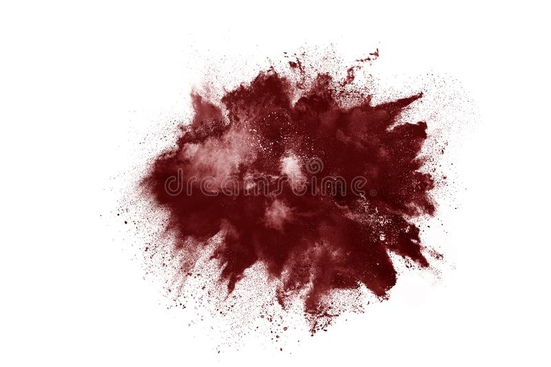 Brown color powder explosion on white background. Colored cloud. Colorful dust explode. Paint Holi stock photography