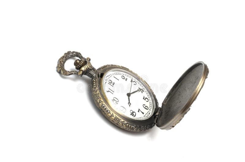 A brown colored carved pocket watch royalty free stock photography
