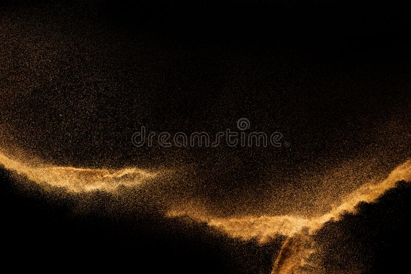 Brown colored sand splash.Dry river sand explosion isolated on black background. Abstract sand cloud.  stock photography