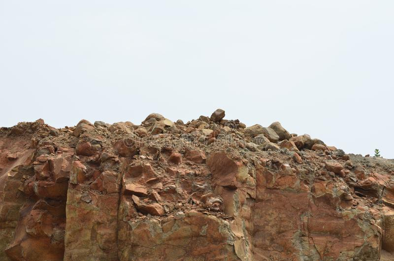 Brown rock near mountain. Brown is a common color for rocks in general at the Earth`s surface. It may take careful observation to evaluate a brown mineral, and royalty free stock photography