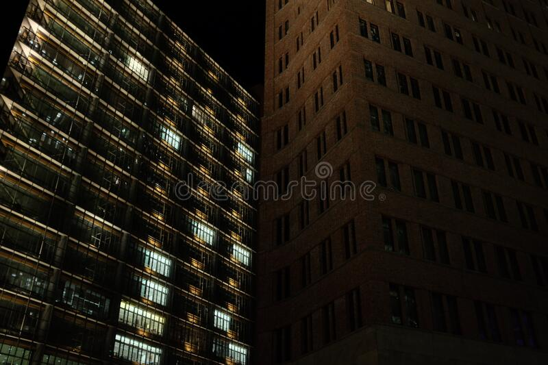 Brown Concrete Building Beside Black Concrete Building During Night Time Free Public Domain Cc0 Image