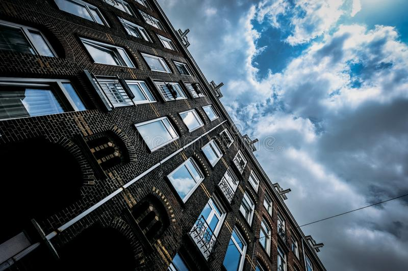 Brown Concrete Building Under Blue and White Cloudy Sky stock image