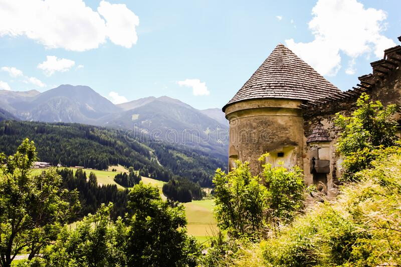 Brown Concrete House Beside Green Tree and Far Mountain on Daytime stock photos
