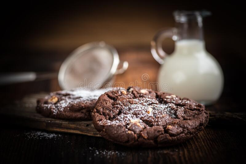 Brown Cookie Chips Near Clear Glass Jar With White Liquid stock photo