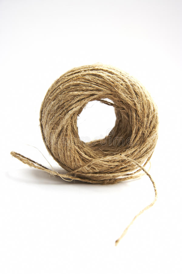 Brown cord ball on white background stock image