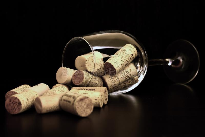 Brown Corks on Clear Wine Glass royalty free stock images