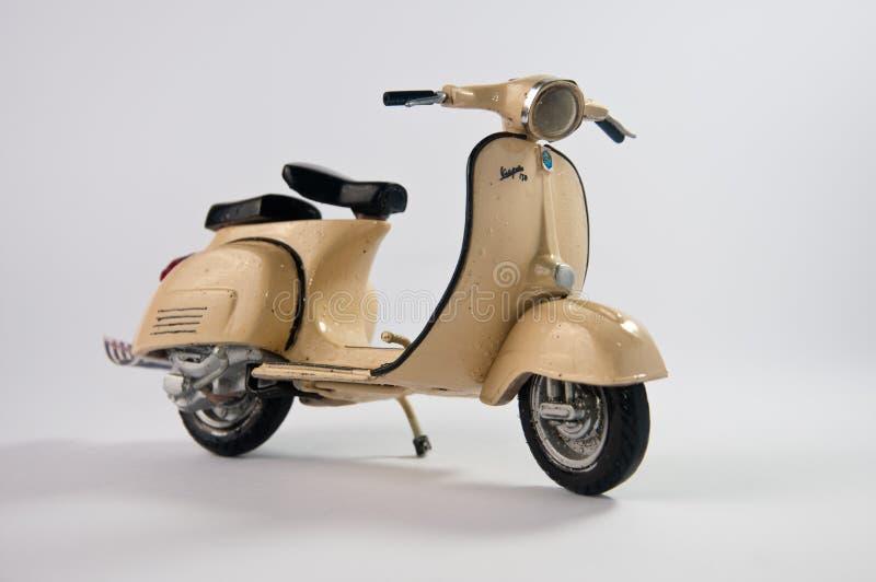 Brown a coulé le scooter sous pression photo libre de droits