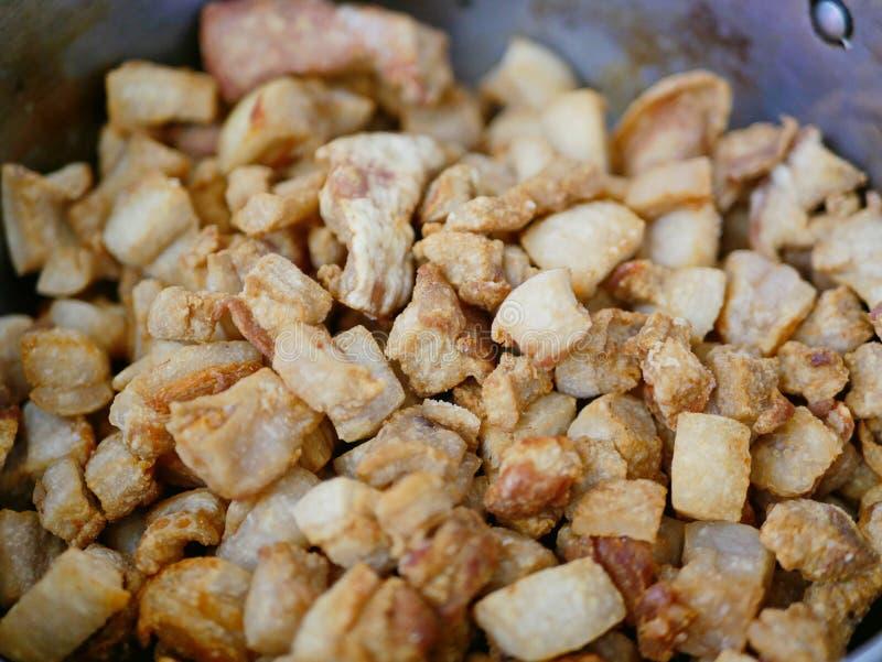 Brown crispy deep fried pork lard crackling Gag Moo / khaep mu. Closeup of brown crispy deep fried pork lard crackling Gag Moo / khaep mu - famous and popular stock image