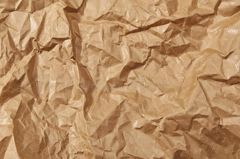 Brown crumpled paper textured background. Close up stock photos