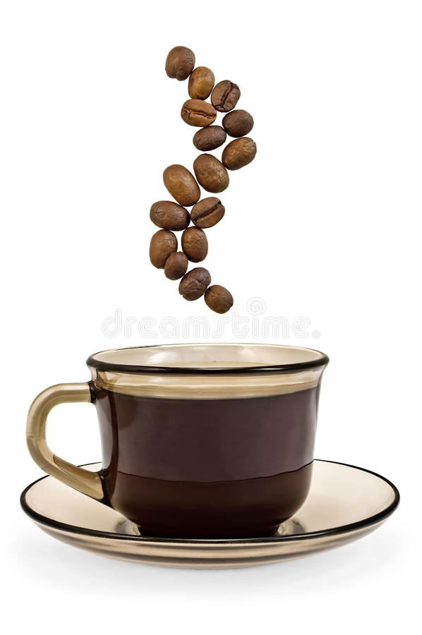 Brown cup of coffee and steam from the grains. A cup of brown glass with coffee and steam coffee beans with a light shade on white background royalty free stock photos