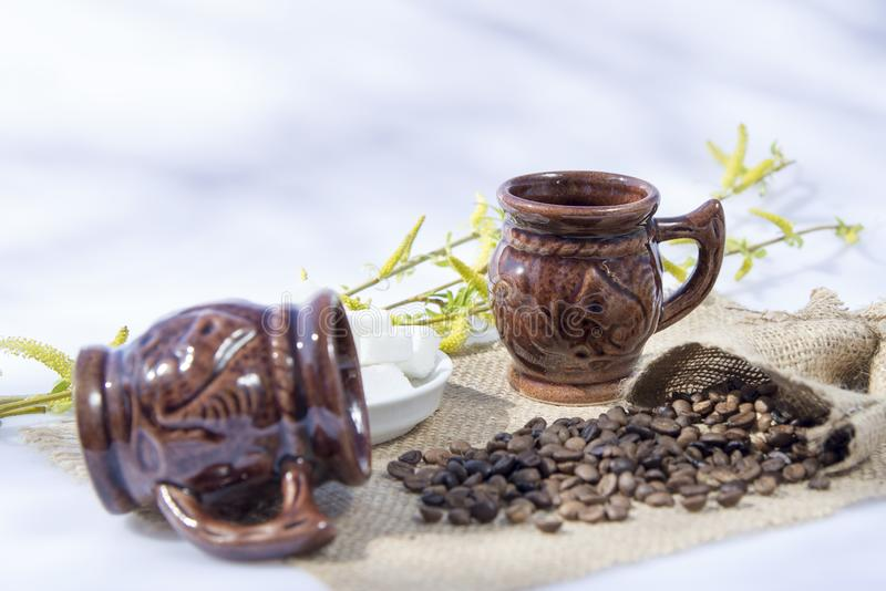 Brown cup for morning coffee. Background royalty free stock image
