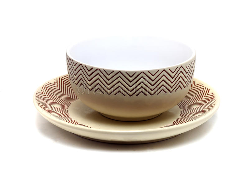 brown cup on a plate stock photo