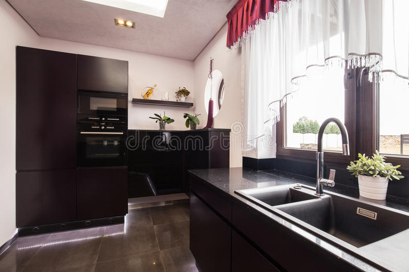 Brown cupboards in luxury kitchen royalty free stock image