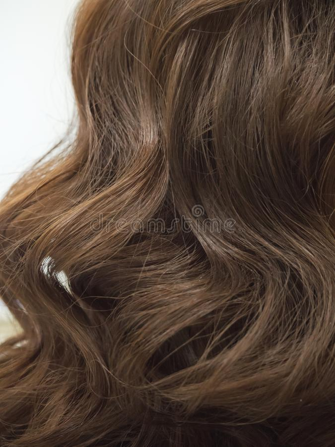 Brown curls of hair, female hairstyles. Close up. royalty free stock photography