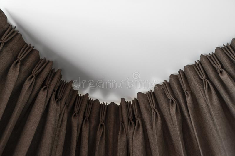 Brown curtains on a rail with a white ceiling. Curtain interior decoration in living or sleeping room. Comfortable live royalty free stock image