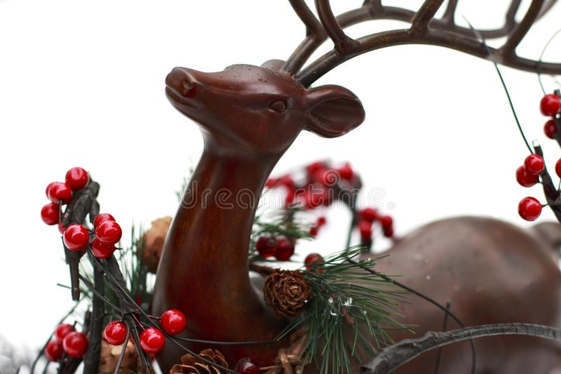Brown decorative Reindeer and Red Berry branches.  stock photography