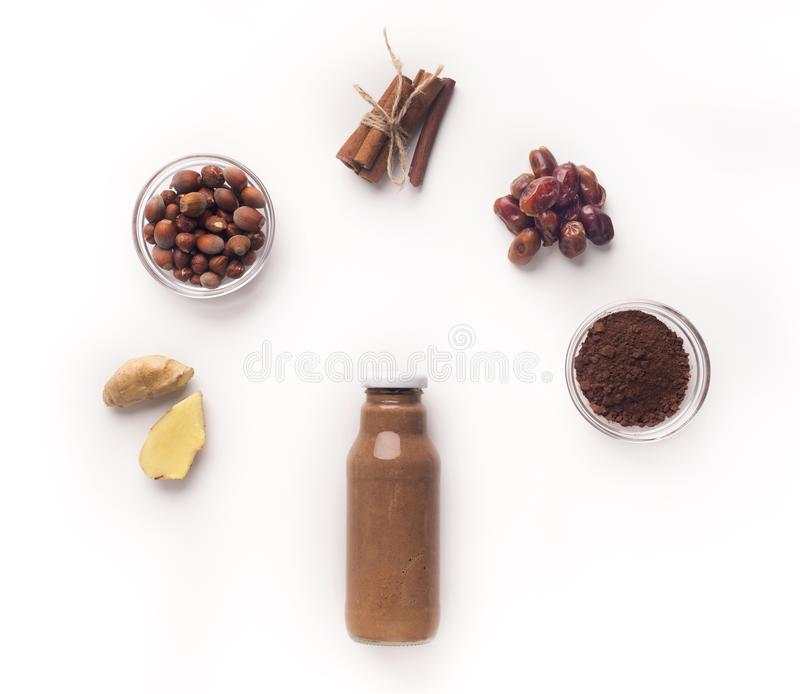 Brown Detox drink smoothie with cinnamon flying on white royalty free stock photos