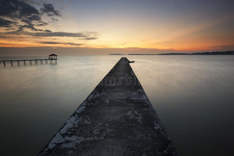 Brown Dock Beside Body Of Water During Sunrise Free Public Domain Cc0 Image