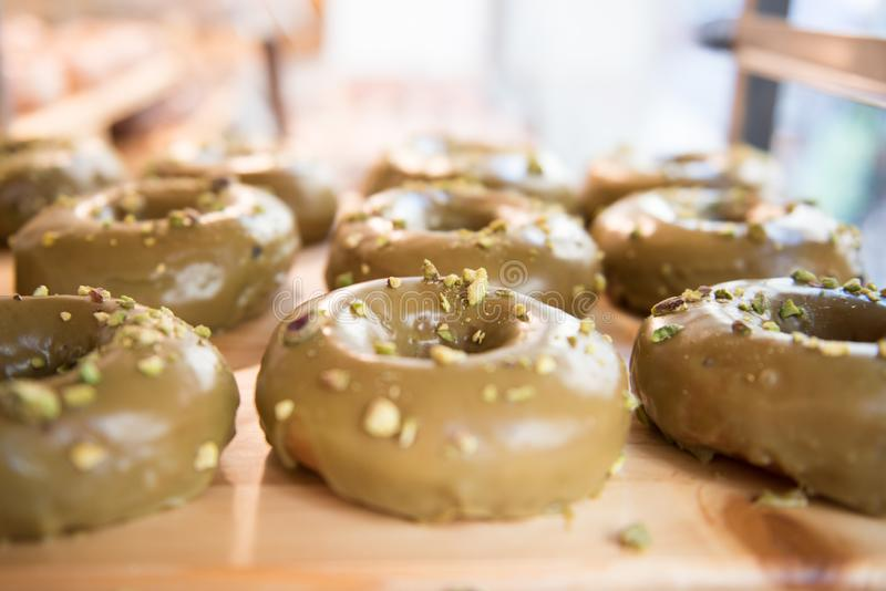Brown donuts on a wooden plate. With white background stock photos