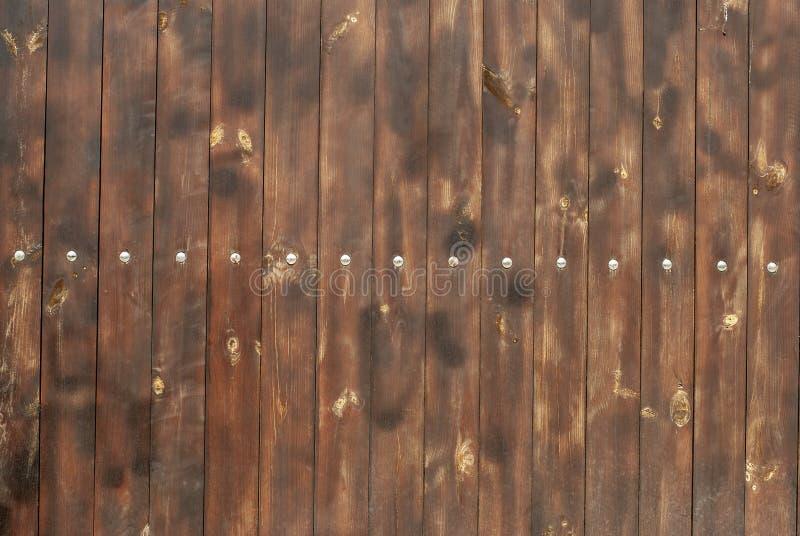 Brown drewniany ogrodzenie, pionowo deski, tło obraz royalty free