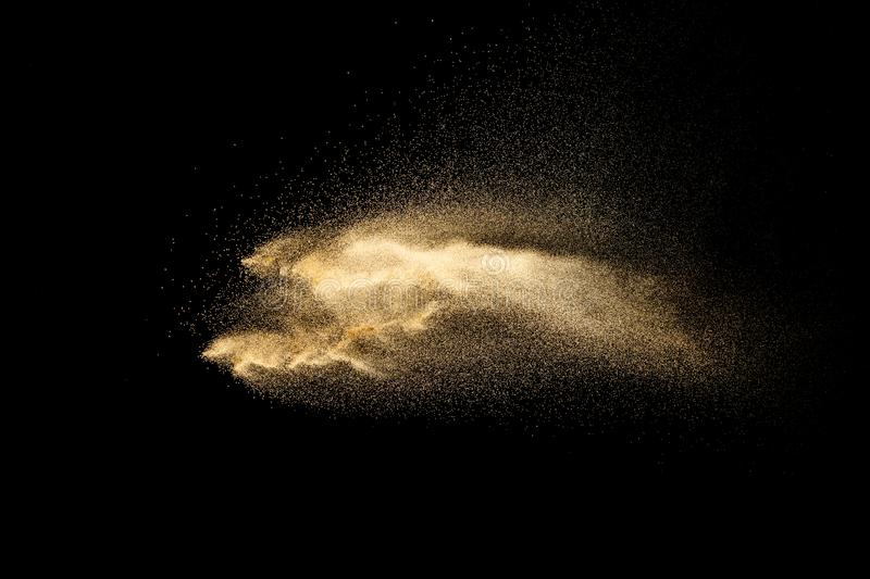 Brown dry river sand explosion isolated on black background. Abstract sand splash royalty free stock image