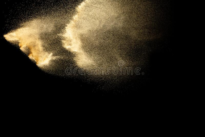 Brown dry river sand explosion isolated on black background. Abstract sand splash stock image