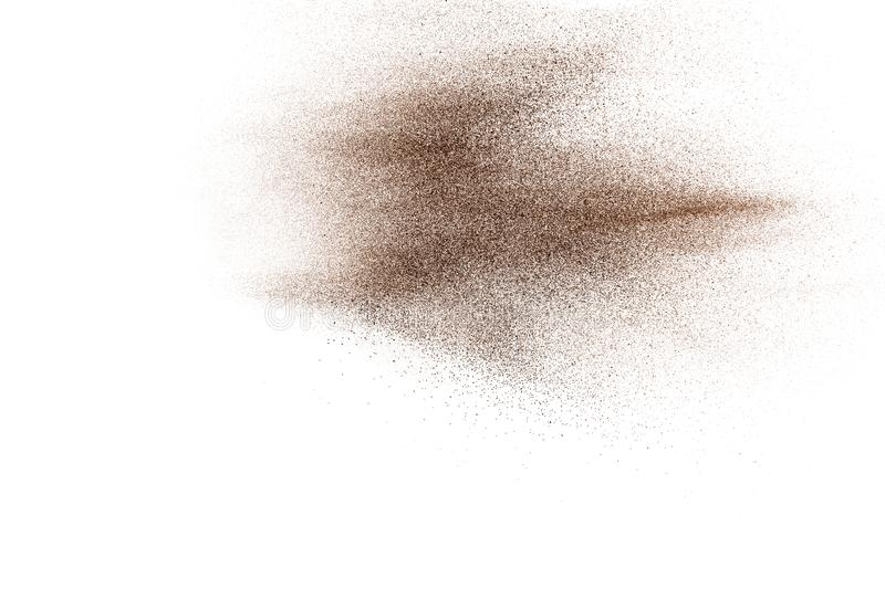 Brown dry river sand explosion isolated on white background. Abstract sand splashing stock photography