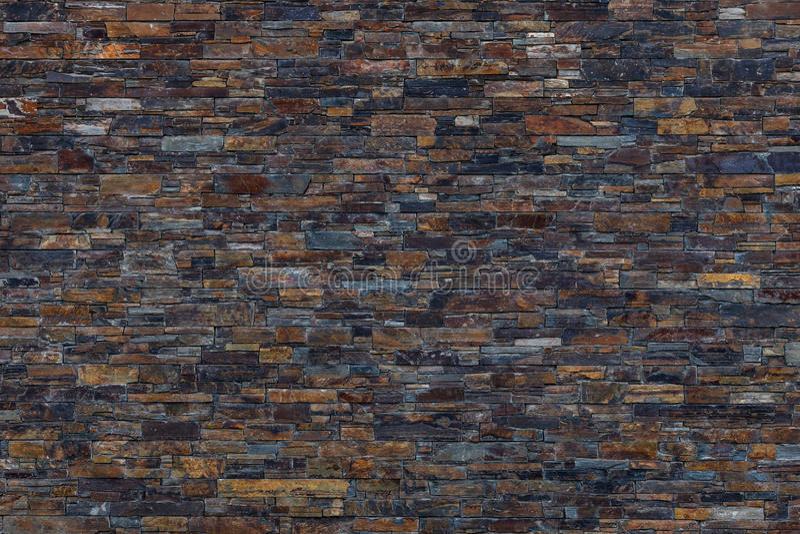 Brown, dunkler Schiefer-Steinwand-Hintergrund lizenzfreie stockfotografie