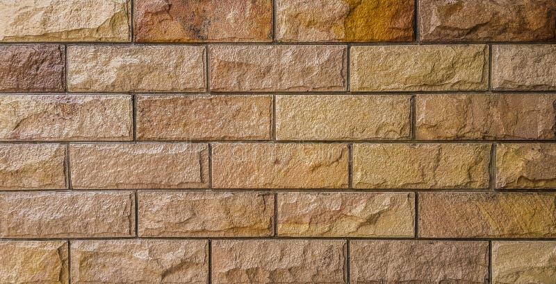 Brown e concreto alaranjado da arte da parede de tijolo imagem de stock royalty free