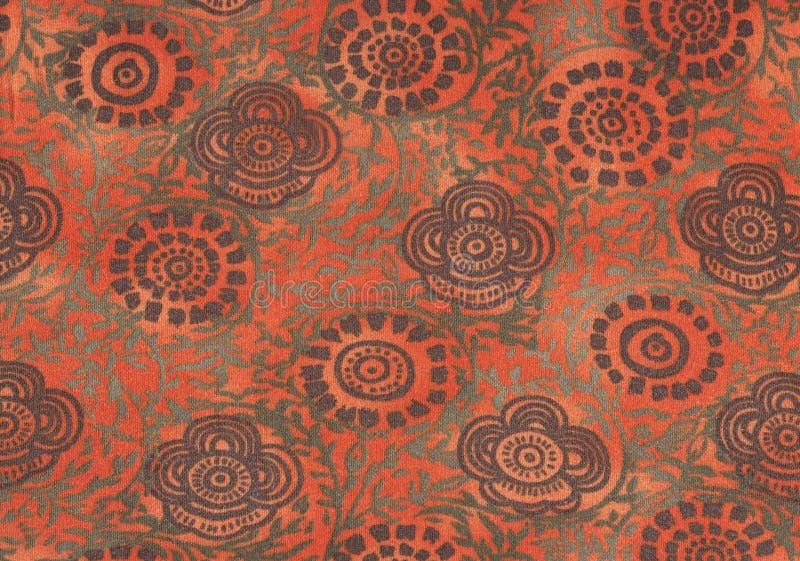 Brown e fiori di verde retro su priorità bassa arancione fotografia stock libera da diritti