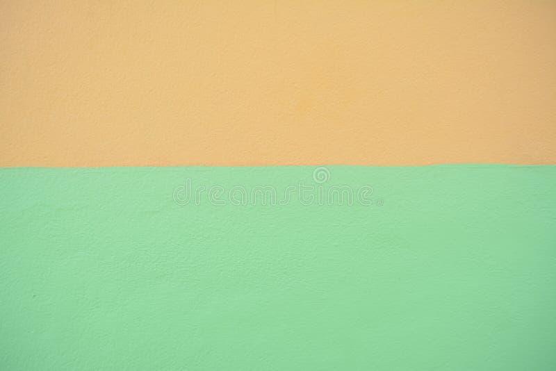 Brown e fondo verde di struttura di colore della pittura del muro di cemento immagini stock