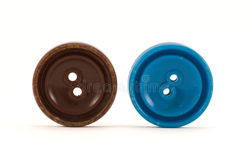 Brown e teclas azuis da roupa fotografia de stock royalty free