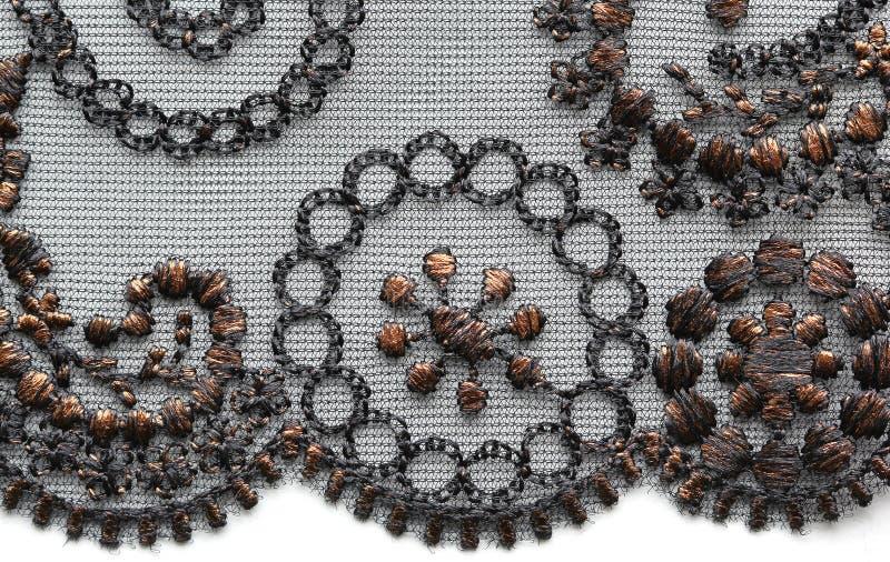 Brown ed il fiore nero merlettano il colpo materiale di macro di struttura immagini stock libere da diritti