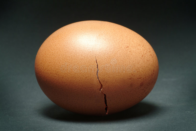 Brown Egg with Cracked Shell stock photo
