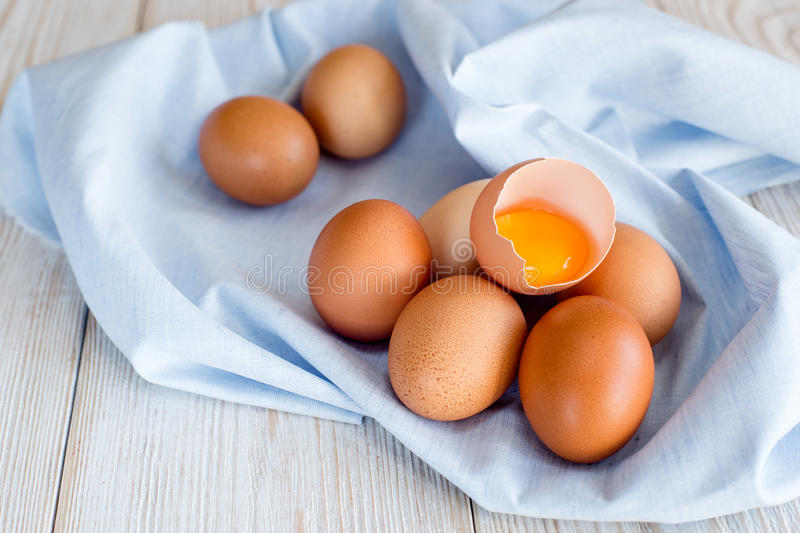 Brown eggs on a blue napkin royalty free stock photography