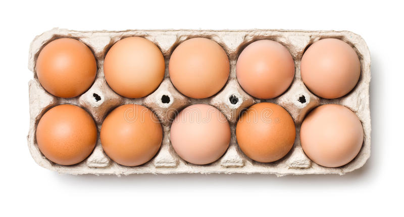 Brown eggs in egg box stock photo