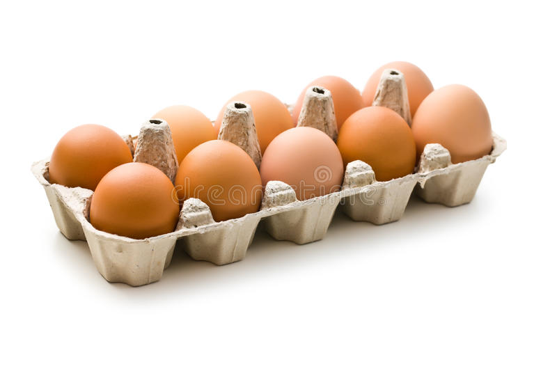 Brown eggs in egg box stock photography