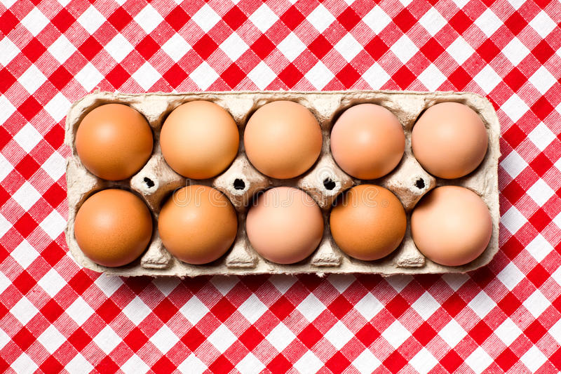 Brown eggs in egg box stock photos