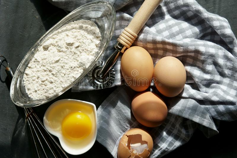 Brown eggs with flour stock photography
